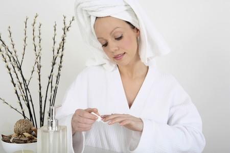 polish: Woman applying nail polish