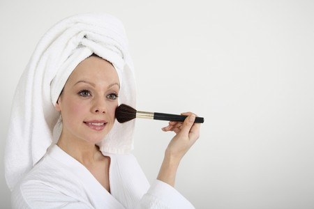 blusher: Woman applying blusher Stock Photo