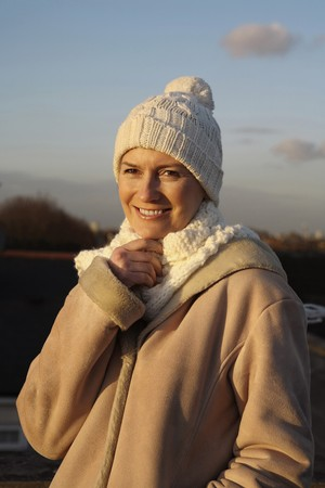 english ethnicity: Woman in warm clothing smiling