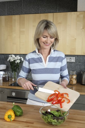 Woman preparing salad in the kitchen Stock Photo - 4111130