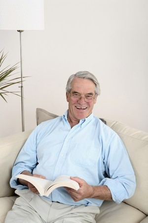 Senior man reading a book photo