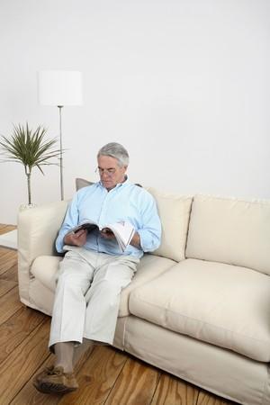 Senior man reading a magazine Stock Photo - 4110379