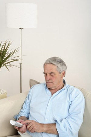 cordless phone: Senior man using cordless phone Stock Photo
