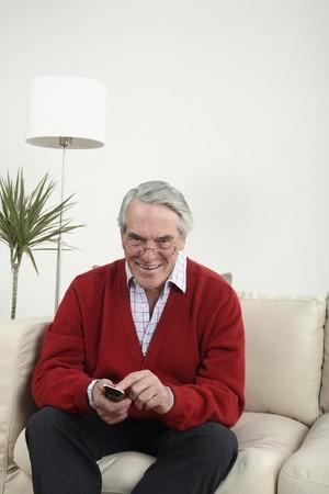 Senior man channel surfing Stock Photo - 4110697