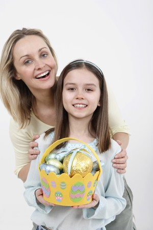 Woman and girl with Easter basket posing for the camera photo