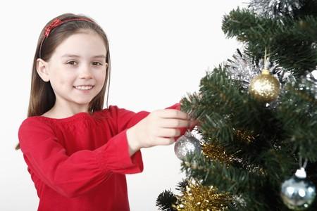 decorating christmas tree: Girl decorating Christmas tree