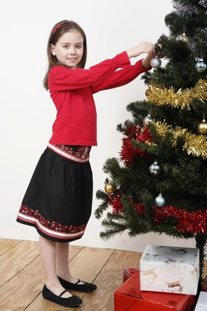 decorating christmas tree: Girl decorating Christmas tree