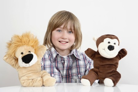 Boy playing with hand puppets photo