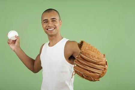 throw up: Man with baseball glove and ball