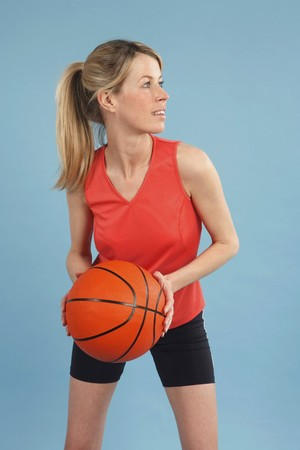 Woman with basketball photo