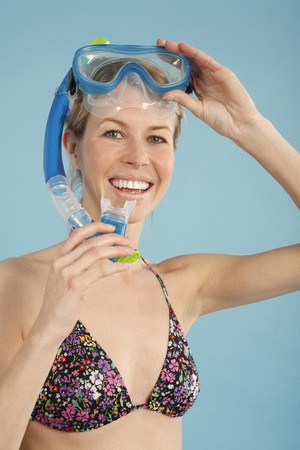 english ethnicity: Woman wearing a snorkle mask