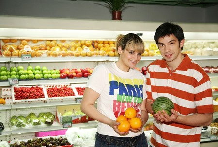 Man and woman buying fruits at the supermarket photo