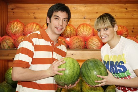 Man and woman choosing watermelon in the supermarket photo