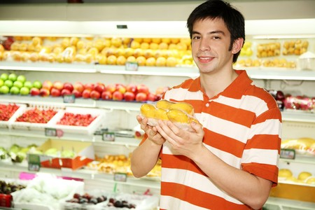 Man holding mangos photo