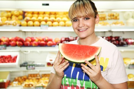 french ethnicity: Woman holding a sliced watermelon