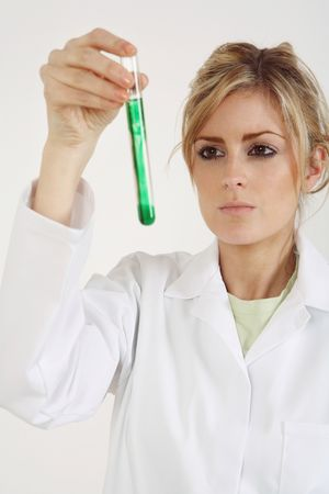 Woman in lab coat holding test tube Stock Photo - 4766956