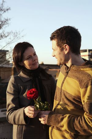 Woman receiving flower from man Stock Photo - 4767188