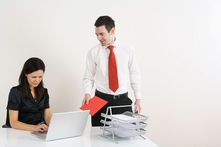 Man giving woman greeting card Stock Photo