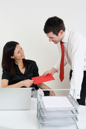 Woman receiving greeting card from man Stock Photo - 4766782