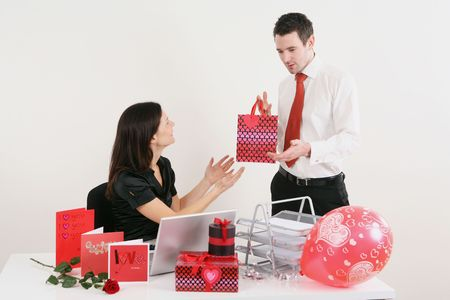 Woman receiving gift from man Stock Photo - 4766994