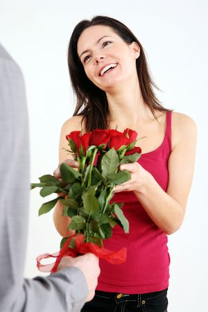 Woman receiving bouquet of flowers from man Stock Photo - 4767185