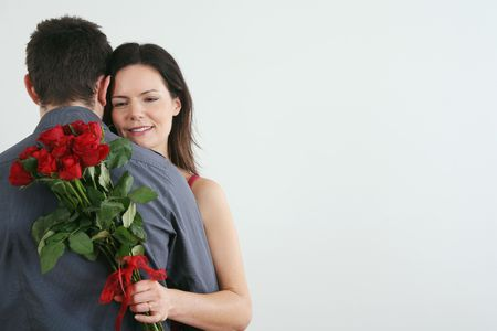 Man and woman embracing, woman holding bouquet of flowers Stock Photo - 4767119