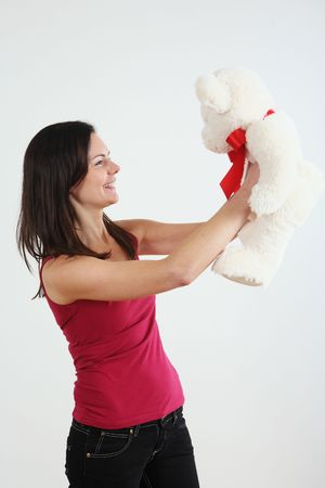 Woman playing with her teddy bear Stock Photo - 4767111