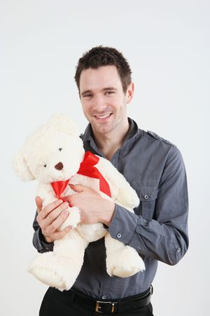 Man embracing his teddy bear