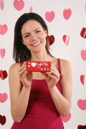 Woman holding wrapped box with message Stock Photo - 4767177