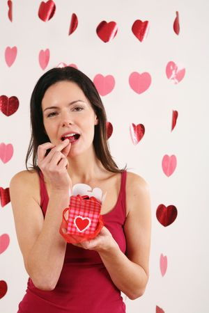 Woman eating chocolate Stock Photo