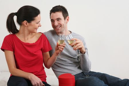 Man and woman toasting champagne photo
