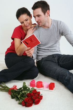 Man and woman reading card Stock Photo - 4767109