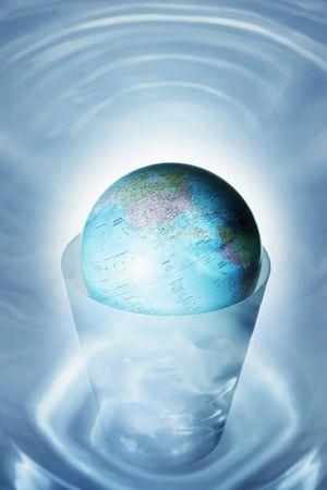 Globe in dustbin Stock Photo