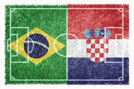 Flags of Brazil and Croatia on soccer field photo