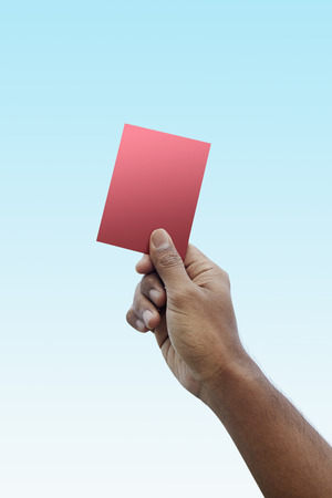 Soccer referee giving red card photo