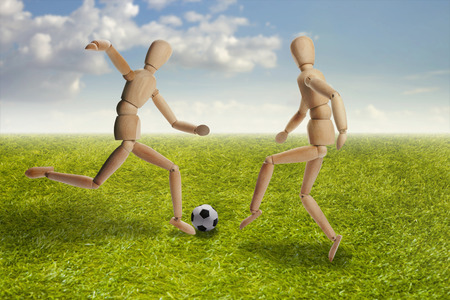 artists dummy: Wooden dummies models playing soccer