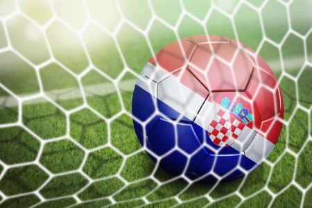 Croatia soccer ball in goal net photo