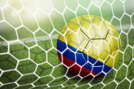 Colombia soccer ball in goal net photo