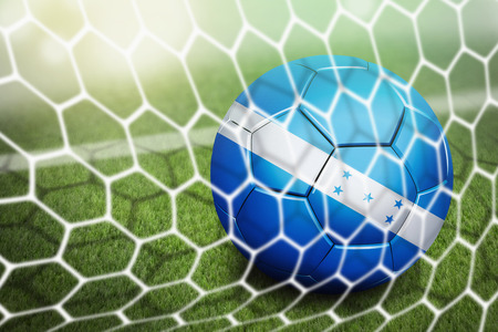 Honduras soccer ball in goal net photo