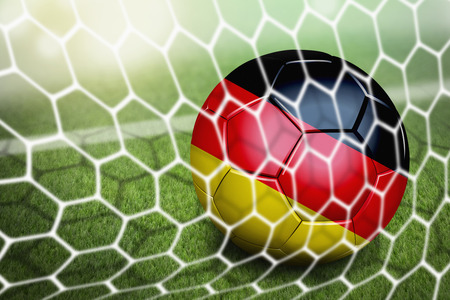 Germany soccer ball in goal net photo