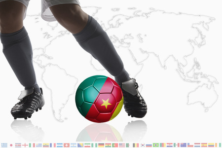 dribble: Soccer player dribble a soccer ball with Cameroon flag