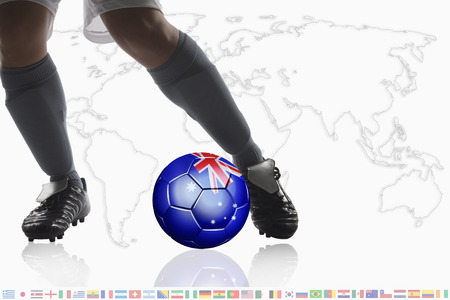 dribble: Soccer player dribble a soccer ball with Australia flag