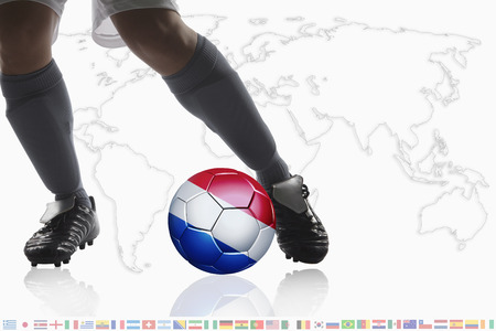 dribble: Soccer player dribble a soccer ball with Netherlands flag