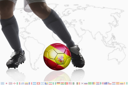 dribble: Soccer player dribble a soccer ball with Spain flag