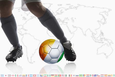 dribble: Soccer player dribble a soccer ball with Ivory Coast flag