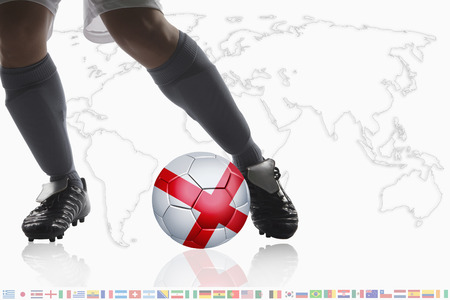 dribble: Soccer player dribble a soccer ball with England flag