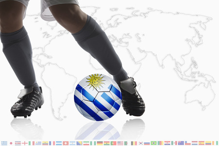 dribble: Soccer player dribble a soccer ball with Uruguay flag