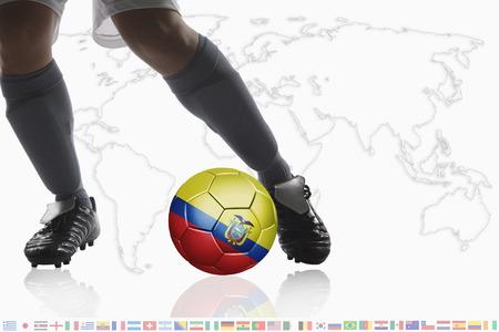 ecuador: Soccer player dribble a soccer ball with Ecuador flag