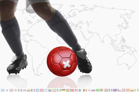 dribble: Soccer player dribble a soccer ball with Switzerland flag Stock Photo