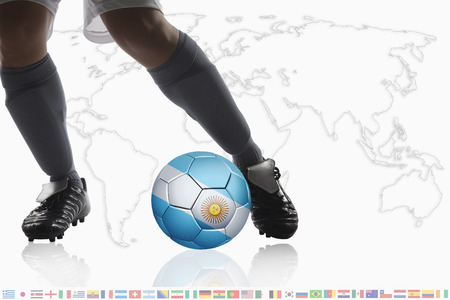 dribble: Soccer player dribble a soccer ball with Argentina flag